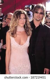 Jennifer Aniston, wearing a vintage Dior dress, and Bratt Pitt at the EMMY AWARDS, 9/22/2002, LA, CA