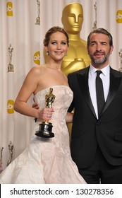 Jennifer Lawrence & Jean Dujardin at the 85th Academy Awards at the Dolby Theatre, Los Angeles. February 24, 2013  Los Angeles, CA Picture: Paul Smith