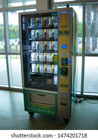 Jennings, Florida / USA - July 2019: Sunpass vending machine inside the Official Florida Welcome Center I-75. Sunpass allows prepaid access through toll booths in Florida. Cut the line, cut the time.
