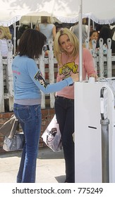 Jenny McCarthy enjoying day with friend at Kidson's. The two goofed off while waiting for there car from the valet in Beverly Hills, Ca , Los Angeles, Ca, 05/21/04