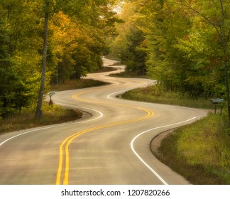 The Jens Jensen curvy road is one of the most photographed roads in the midwest. It is located on Highway 42 between Gills Rock and Northport on the northern tip of Door County in Wisconsin.