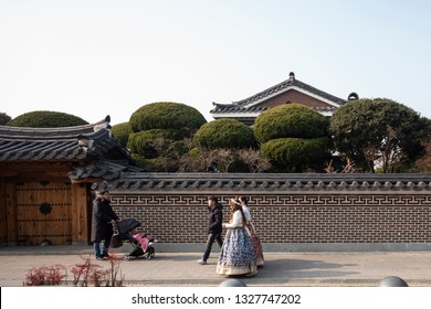 Jeonju, South Korea - January 13 2019: Tourists wear traditional Korean clothes and walk around Jeonju Hanok Village