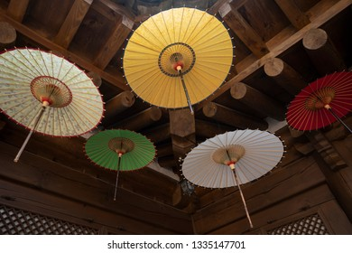 Jeonju, South Korea - January 13 2019: The colorful umbrellas are hung as decoration in a tradition hanok in old town Jeonju.