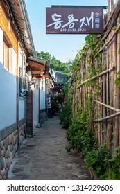Jeonju, South Korea - September 2018: Narrow alley between ancient Korean houses in Jeonju Hanok Village, popular tourist attraction designated as an International Slow City in 2010