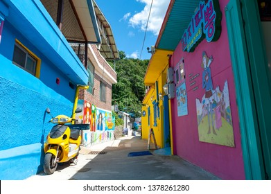 Jeonju, South Korea - September 2018: Colourful paintings and decorations on walls and buildings at Jaman Mural Village, popular tourist attraction in Jeonju, South Korea