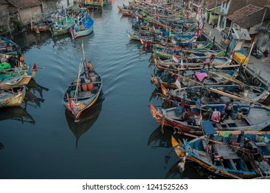 Jepara, Central Java, Indonesia - July 23, 2015. Fishermen carrying their boats in a fishermen's village are lined with beach Kartini Jepara, Central Java, Indonesia.