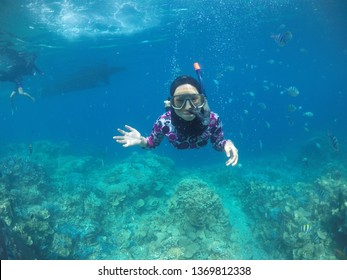 Jepara, indonesia - 6th october 2017 : a people diving in the karimunjawa island at a afternoon