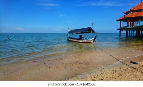 JEPARA, INDONESIA- 8 may 2019: fishing boat anchored near the dock, landscape background and wallapaper