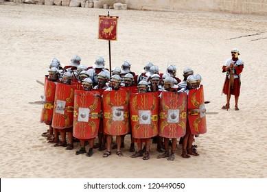 JERASH - JORDAN - NOVEMBER 25: Jordanian men dress as Roman soldier during a roman army reenactment show on November 25, 2009 in Jerash, Jordan