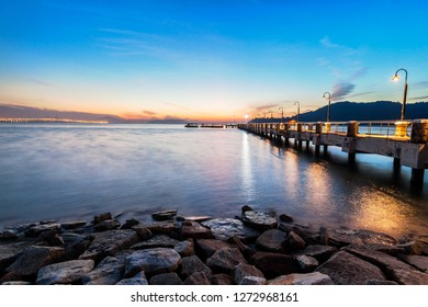 Jerejak Pier view during sunrise by the shore of Bayan Mutiara