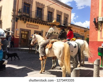 Jerez, Zacatecas/México. Agust,16,2018. Traditional local wedding. Charro friends of the groom waiting for him outside church on horses.