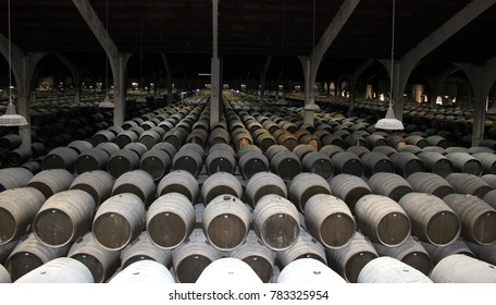 Jerez de la Frontera, Andalucia, Spain - November 09, 2017: Wine production/ Huge hall with dusty wooden barrels of sherry in a wine cellar