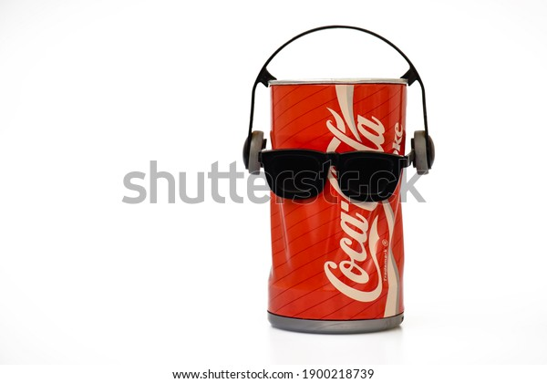 Jerez de la Frontera, Cadiz, Spain, January 22, 2021, vintage Coca-Cola can with sunglasses and headphones, which dances, moves with rhythm.