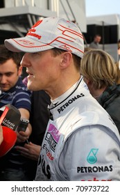 JEREZ DE LA FRONTERA - FEBRUARY 11: Michael Schumacher from Germany and Mercedes GP attends press after driving in winter test at Circuito de Jerez on February 11, 2011 in Jerez de la Frontera, Spain