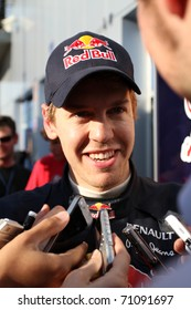 JEREZ DE LA FRONTERA - FEBRUARY 12: German Sebastian Vettel and Red Bull Racing atends media after day three of winter test at Circuito de Jerez on February 12, 2011 in Jerez de la Frontera, Spain