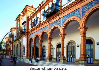 JEREZ DE LA FRONTERA, SPAIN - AUGUST 09, 2014: People walking near the authentic building of the train station. Jerez de la Frontera is famous touristic place.