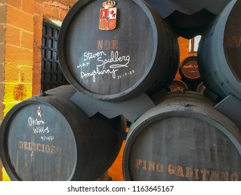 Jerez de la Frontera, Spain / April 12, 2017: Sherry wine cellar. Fortified wine made from white grapes that are grown near the city. Old wooden barrels of wine. Andalusia.