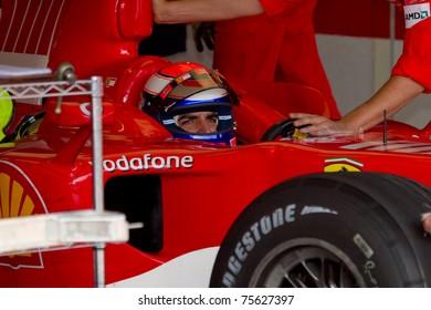 JEREZ DE LA FRONTERA, SPAIN -  OCT 10: Marc Gene of Scuderia Ferrari F1 waiting in the boxes on training session on October 10, 2006 on training session in Jerez de la Frontera , Spain