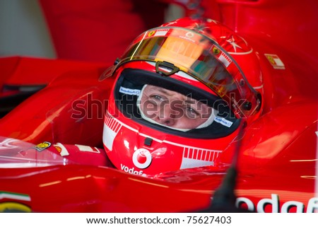 JEREZ DE LA FRONTERA, SPAIN -  OCT 11: Michael Schumacher of Scuderia Ferrari F1 waiting in the boxes on training session on October 11, 2006 on training session in Jerez de la Frontera , Spain