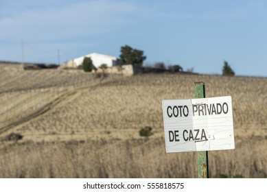 JEREZ, SPAIN - FEBRUARY 2014: Sign COTO PRIVADO DE CAZA indicating that the hunting rights are private or private property, do not hunt here.