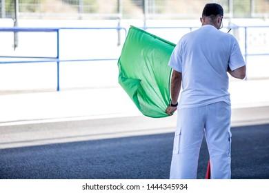 JEREZ, SPAIN-SEPTEMBER 22, 2018: Iberian Historic Endurance. Circuit worker with green flag at Circuito de Jerez, Ángel Nieto in Spain.