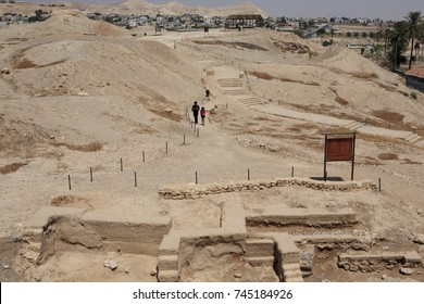 Jericho, Palestine - Aug 27, 2010: 2 tourist walking along the relic of the ancient Jericho, which was built 10000 years ago.