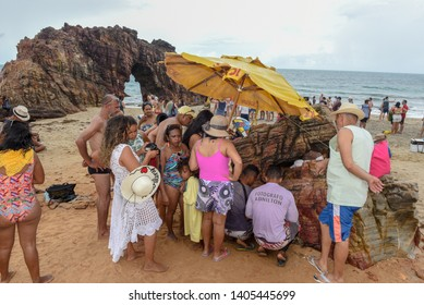 Jericoacoara, Brazil - 9 January 2019: people waiting for the print of the souvenir photo in front of the natural arch of Jericoacoara on Brazil
