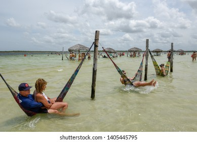 Jericoacoara, Brazil - 9 January 2019: people relaxing on hammocks at Jericoacoara on Brazil