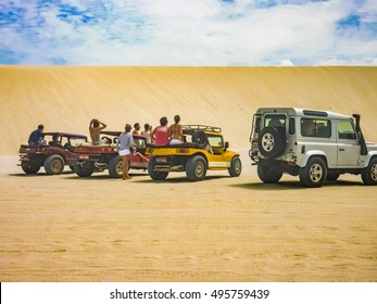 JERICOACOARA, BRAZIL, JANUARY - 2016 - Group of people at cars at dunes in Jericoacoara National Park in Brazil
