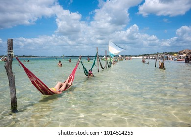 Jericoacoara, Brazil - July 20, 2016: Woman relaxing on hammock and do selfie on vacation on the the Paradise Lake, Jericoacoara, Brazil