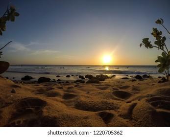 Jericoacoara, Ceará, Brazil. October 2018. Surfers at sunset on the beach of Jericoacoara, northeast Brazil.