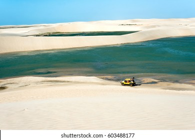 Jericoacoara, Ceara state, Brazil - July 2016: Buggy with tourists traveling through the desert Jericoacoara National Park