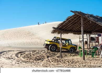 Jericoacoara, Ceara state, Brazil - July 17, 2016: Buggy and moto with tourists traveling through the desert Jericoacoara National Park
