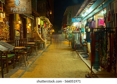 JERICOACOARA, JANUARY - 2017 - A sand street with rustic style restaurants and stores in Jeri at night. This is a hidden paradise in Ceara, Brazil, one of the most beautiful destination in the world.