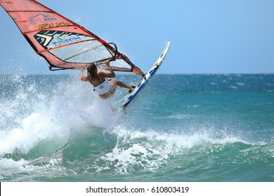 JERICOACOARA.CEARA/BRASIL - CIRCA JANUARY 2017: windsurfer italian femail sportmen Laura rjumping on the wave having fun of the windsurfing