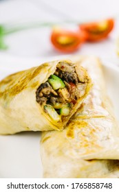 Jerk Chicken Shawarma with tomato and cucumber