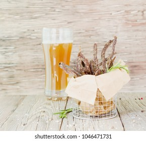 jerked meat, cow, deer, wild beast or biltong with beer on a rustic table, selective focus