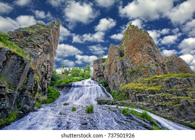 Jermuk waterfall, Vayots Dzor, Armenia. It has 72 m height and spilling slant into Arpa River reminds girl's hair. Hence another name for a waterfall, Mermaid hair. Dramatic bluff rocks