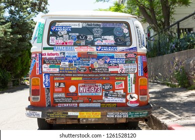 Jeroma, Arizona / USA 11/19/2015 A Volkswagen bus covered in bumper stickers is parked on a side street in the historic mining town of Jerome Arizona.