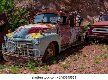 JEROME, ARIZONA - JULY 2019: Gold King Mine Ghost Town is home to an incredible collection of rusted, junked out, early to mid-century commercial trucks.
