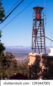 Jerome, Arizona, USA 04/21/2019 The old fire siren on top of the fire department with the Coconino National Forest in the distant background