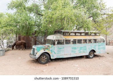 Jerome, AZ, USA - April 16, 2018: a very old bus at the Gold King Mine & Ghost Town. The town is funky stop with dilapidated buildings, an old mine & a large collection of old autos & trucks.