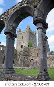 Jerpoint Abbey Central tower viewed through a cloister archway. Jerpoint Abbey is located in Thomastown Co. Kilkenny.
