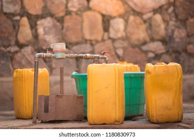 Jerrycans and buckets next to a tap to collect water in Nyamirambo, a semi-rural part of Kigali, Rwanda