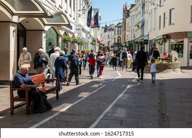 JERSEY, CHANNEL ISLANDS - 06082018:  View along a crowded King Street, the main shopping area in Saint Helier