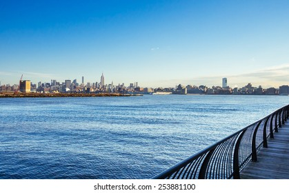 Jersey City - NJ 30 dec 2014: manhattan skyline view from harborside hudson river at dawn time in jersey city