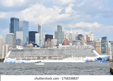 JERSEY CITY, NJ - AUG 4: Norwegian Escape cruise ship, sailing away from New York City, as seen from Liberty State Park in Jersey City, New Jersey, on Aug 4, 2019.