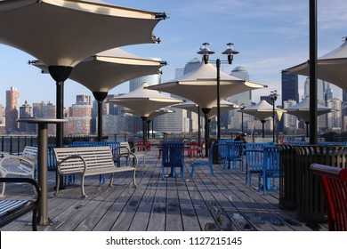 Jersey City, NJ - August 2 2009: The viewpoint of Jersey City Exchange Place Pier to Manhattan.