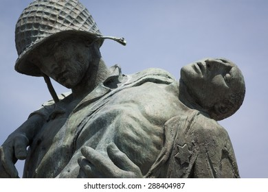 JERSEY CITY, NJ - MAY 26 2015: Close-up view of the Liberation Monument, a memorial to the Holocaust depicting a US soldier carrying a Nazi death camp survivor at Liberty State Park.