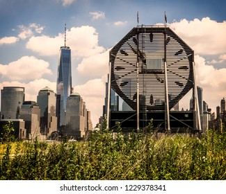 Jersey City, NJ / United States - June 29, 2018: Colgate Clock with Lower Manhattan in the distance.